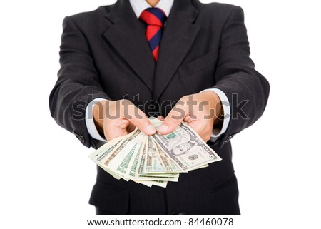 Image of a business man holding money, isolated on white - stock photo