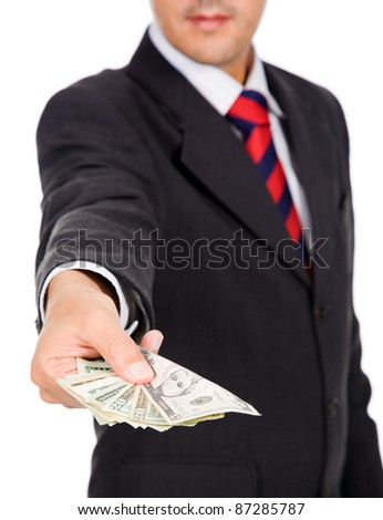 Image of a business man offering money, isolated on white - stock photo