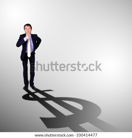 Image of a business man with a shadow shaped as a currency sign