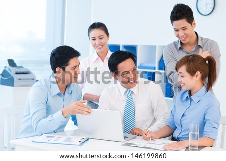 Image of a business team discussing ideas at the office - stock photo
