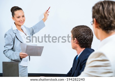 image of a Business woman showing a presentation to colleagues - stock photo