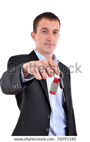 image of a businessman gives the keys to the car. Isolated on white - stock photo