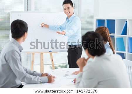 Image of a businessman presenting a new strategy to his colleagues - stock photo