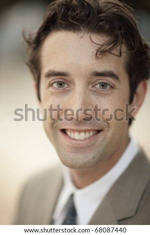 Image of a businessman smiling - stock photo