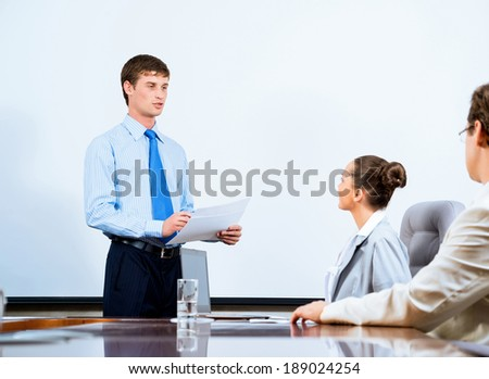 image of a businessman talking to colleagues, teamwork in the office