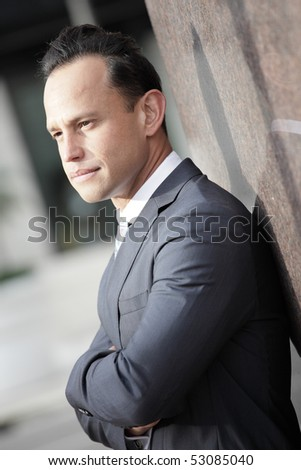 Image of a businessman with his arms crossed