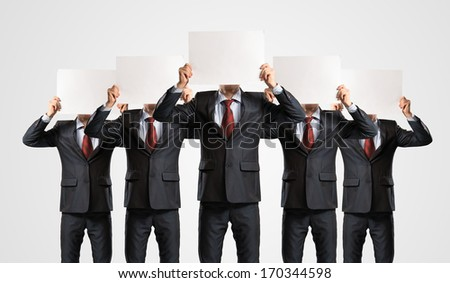 image of a businessmen standing in a row, held in front of a blank poster