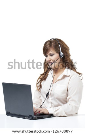Image of a businesswoman wearing a headset and using her laptop against white background
