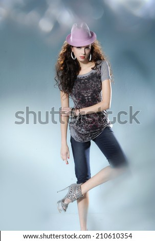 image of a casual young fashion in hat posing  - stock photo