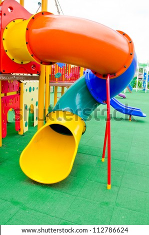 Image of a colorful children's playground in suburban area. - stock photo