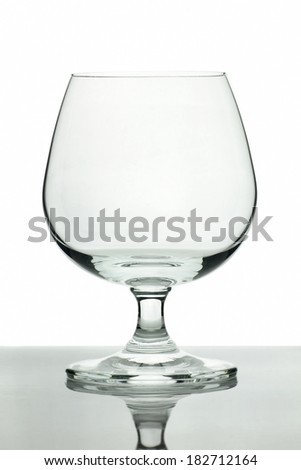 Image of a common wine glass lay on table with white background - stock photo