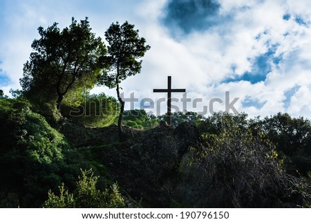 Image of a cross at the mountain  - stock photo