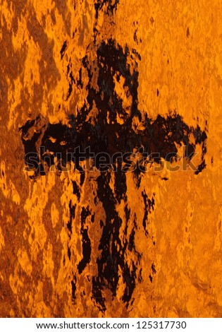 Image of a cross taken through textured gold glass