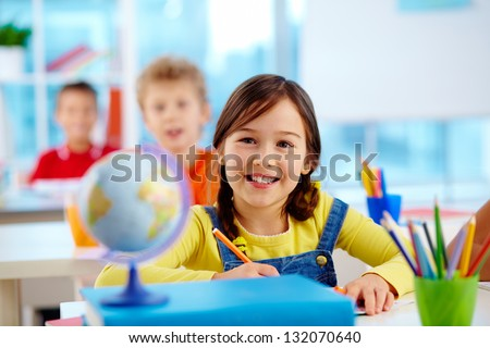 Image of a cute pupil with cheerful smile - stock photo