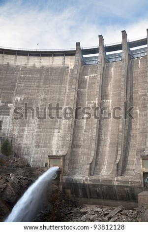 Image of a dam draining water to the river. - stock photo