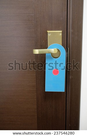 image of a Do not disturb sign hang on door knob - stock photo