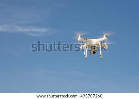 Image of a drone under blue sky
