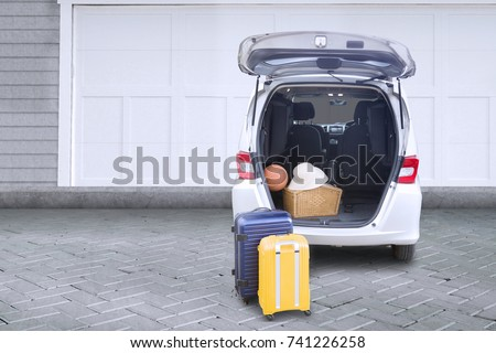 Image of a family car for summer holiday and parking in the house garage