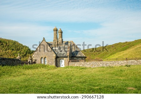 Image of a farmhouse in fields - stock photo