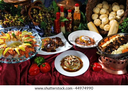 Image of a feast of different foods on a decorative table - stock photo