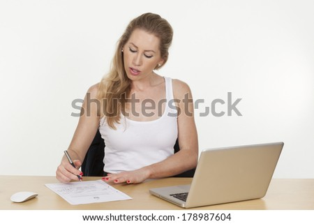 Image of a female businesswoman writing on a document, isolated on white background.