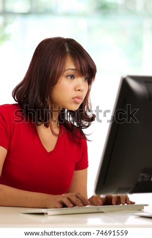 Image of a female working at desk - stock photo