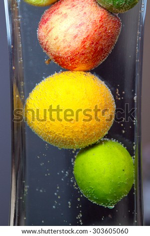 image of a fresh fruits in water - stock photo