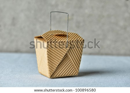 """Image of a generic """"to go"""" box made of recycled brown cardboard - stock photo"""