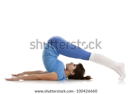 Image of a girl practicing yoga on white - stock photo