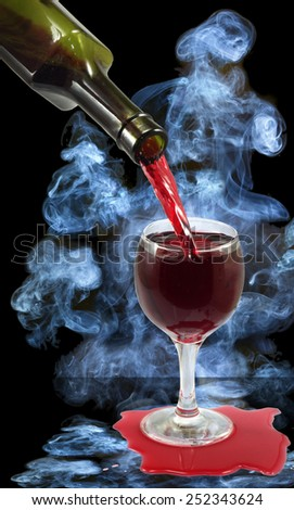 image of a glass of wine and a bottle on smoke background - stock photo