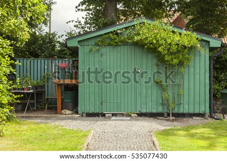 Image of a green garden shed.