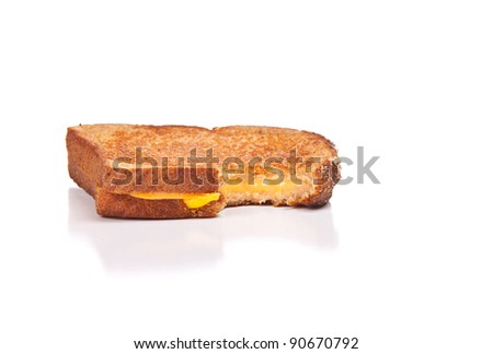 Image of a grilled cheese sandwich missing a bite isolated on white.