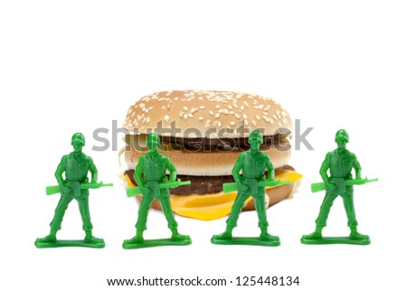 Image of a group of brave soldiers guarding the delicious hamburger on a white background - stock photo