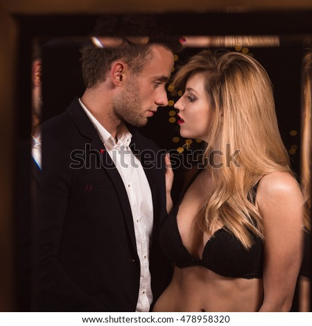 Image of a half naked female seducing a handsome man