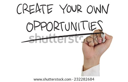 Image of a hand holding marker and write create your own opportunities words isolated on white - stock photo