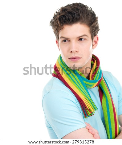 image of a handsome young man shot with scarf in studio - stock photo