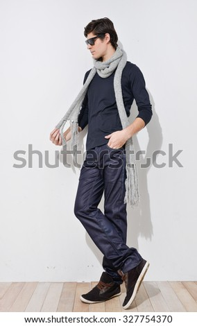 image of a handsome young man with scarf shot in studio - stock photo