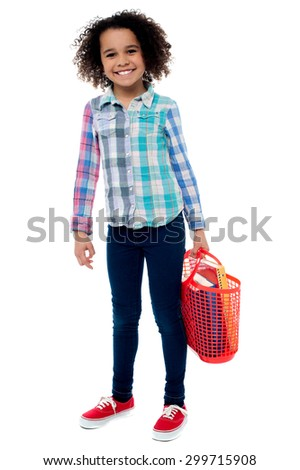 Image of a happy girl with basket over white - stock photo
