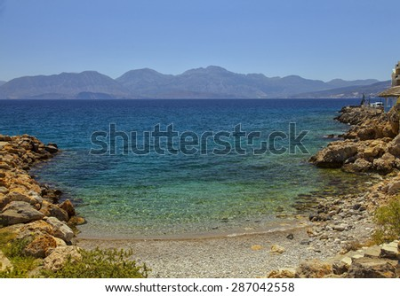 Image of a lite cove beach in Agios Nikolaos. Crete, Greece.  - stock photo
