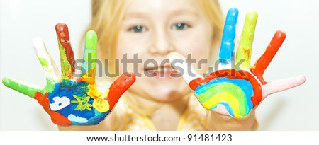 image of a little girl with hands painted, See my portfolio for more - stock photo