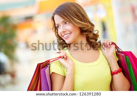 Image of a lovely shopping lady holding her purchases - stock photo