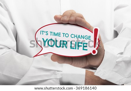Image of a man hand holding speech bubble with the text it is time to change your life, white shirt. Conceptual message for motivation and goal achievement. - stock photo