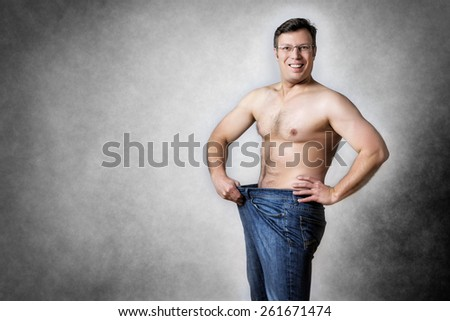 Image of a man in blue jeans who has lost body weight - stock photo