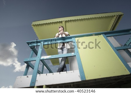 Image of a man on a colorful lifeguard hut