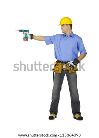 Image of a manual construction worker wearing tool belt, hard hat and holding drill machine