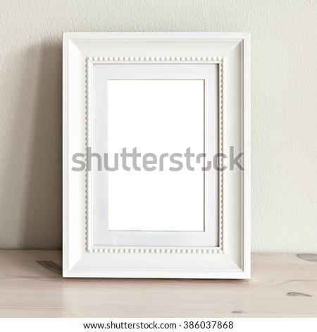 Image of a mockup scene with ornate white frame.  - stock photo