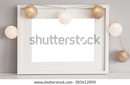 Image of a mockup scene with white landscape frame with baubles.  - stock photo