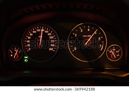 Image of a modern speedometer shows rpm number in high speed - stock photo