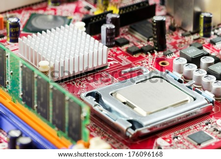 Image of a motherboard with CPU socket, heatsink and electrical components. - stock photo