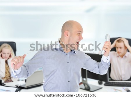 image of a nervous businessman screaming on the phone. - stock photo